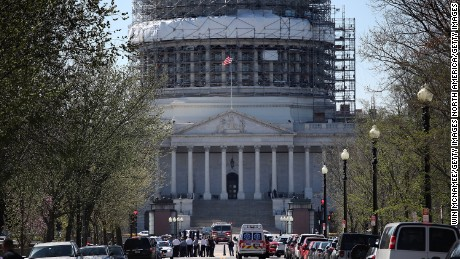 "WASHINGTON, DC - MARCH 28:  Emergency personnel and law enforcement officers gather outside the U.S. Capitol after at least one person was shot in the Capitol Visitor Center March 28, 2016 in Washington, DC. The Capitol was placed in ""lock down"" following the shooting.  (Photo by Win McNamee/Getty Images)"