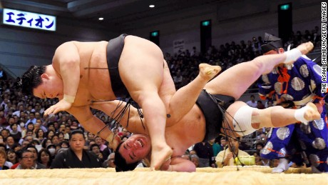 OSAKA, JAPAN - MARCH 23:  (CHINA OUT, SOUTH KOREA OUT) Ozeki Goeido (L) throws Mongolian yokozuna Harumafuji (R) to win during day eleven of the Grand Sumo Spring Tournament at the Edion Arena Osaka on March 23, 2016 in Osaka, Japan.  (Photo by The Asahi Shimbun via Getty Images)