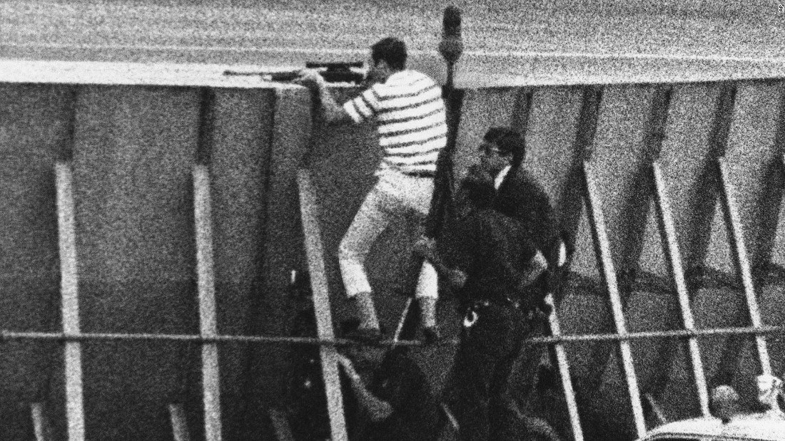 In 1971, a hijacker, tentatively identified as Richard Oberfell of Passaic, New Jersey, forced a Chicago-bound plane to land at New York's LaGuardia Airport. He then took two hostages in a maintenance truck on a nine-mile ride to JFK International Airport. There, FBI agents climbed a protective wall as they hunted down the hijacker, who demanded a plane to take him to Italy. FBI agent Kenneth Lovin, dressed in a striped shirt, fired fatal shots that killed the hijacker.