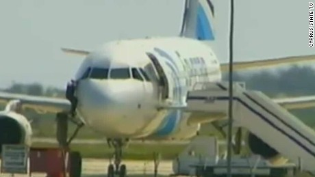 Man seen climbing out of EgyptAir cockpit window