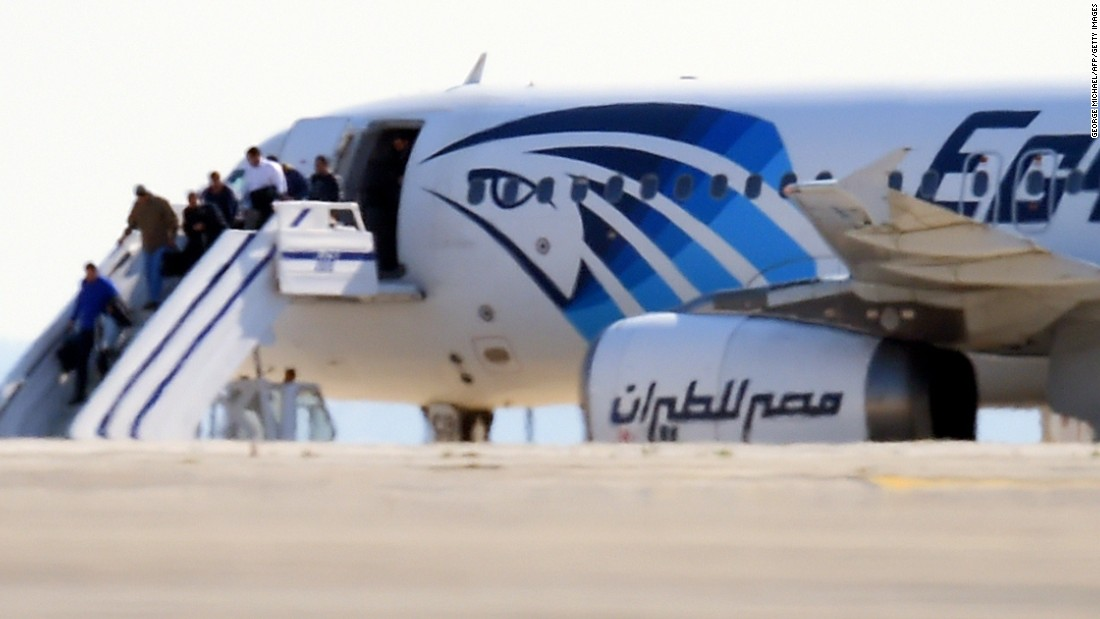 """EgyptAir Flight 181 en route to Cairo from Alexandria <a href=""""http://www.cnn.com/2016/03/29/europe/hijacked-egypt-air-jet/index.html"""">was hijacked and diverted to Cypress</a> on Tuesday, March 29. Here, some passengers disembark on the tarmac at Larnaca International Airport in Cyprus. All the passengers eventually were released and the hijacker arrested, according to the airline and Cypriot authorities."""