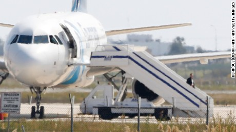 A man believed to be the hijacker of the EgyptAir Airbus A-320, which was diverted to Cyprus, leaves the plane on March 29, 2016.  The hijacker who seized the Egyptian airliner and forced it to land in Cyprus has been detained, Cypriot government spokesman Nicos Christodoulides said. / AFP / BEHROUZ MEHRI        (Photo credit should read BEHROUZ MEHRI/AFP/Getty Images)