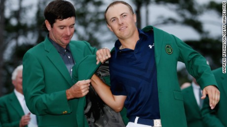 AUGUSTA, GA - APRIL 12:  Bubba Watson presents Jordan Spieth of the United States with the green jacket after Spieth won the 2015 Masters Tournament at Augusta National Golf Club on April 12, 2015 in Augusta, Georgia.  (Photo by Andrew Redington/Getty Images)