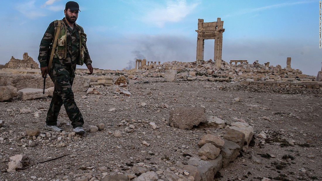 "<strong>After:</strong> A Syrian government soldier walks near what's left of the Temple of Baalshamin on Sunday, March 27. Syrian forces retook the city days before, but damage had already been done by ISIS. UNESCO says it plans to evaluate the extent of <a href=""http://www.cnn.com/2016/03/28/middleeast/isis-palmyra-treasures-destroyed/index.html"" target=""_blank"">Palmyra's damage</a> soon. Many of the structures -- which date from the first and second centuries and marry Greco-Roman techniques with local traditions and Persian influences -- remain in place, bolstering hopes that ISIS didn't completely raze the world heritage site."