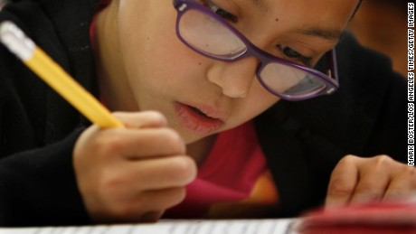In this file photo fourth grader Zeimi Deleon takes at test at Los Angeles Elementary School.
