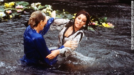 """UNITED STATES - APRIL 13:  DYNASTY - """"The Threat"""" - Season Three - 4/13/83, Krystle (Linda Evans) and Alexis's (Joan Collins) argument about Fallon resulted in a brawl in the Carrington lily pond.,  (Photo by ABC Photo Archives/ABC via Getty Images)"""