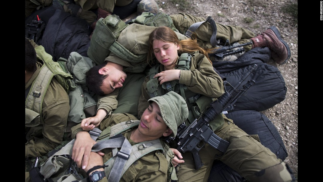 Israeli soldiers rest during an exercise near Regavim, Israel, on Tuesday, March 29. The infantry battalion