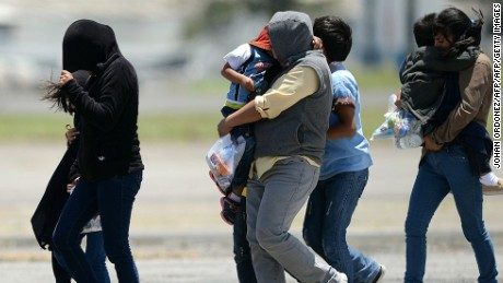 Part of a group of thirteen children, aged between one and 13, and seven mothers walk upon arrival in Guatemala deported from the United States amidst the humanitarian crisis caused by Central American immigrant children, at the Air Force Base in Guatemala City on July 22, 2014. US authorities have detained some 57,000 unaccompanied minors since last October, twice the number from the same period a year ago, seeking to illegally cross into the US from Mexico. Three quarters of the minors are from El Salvador, Guatemala and Honduras.    AFP PHOTO / Johan ORDONEZ        (Photo credit should read JOHAN ORDONEZ/AFP/Getty Images)