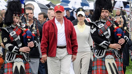 Caption:US tycoon Donald Trump (C) is escorted by Scottish pipers as he officially opens his new multi-million pound Trump International Golf Links course in Aberdeenshire, Scotland, on July 10, 2012. Work on the course began in July 2010, four years after the plans were originally submitted. AFP PHOTO / Andy Buchanan (Photo credit should read Andy Buchanan/AFP/GettyImages)