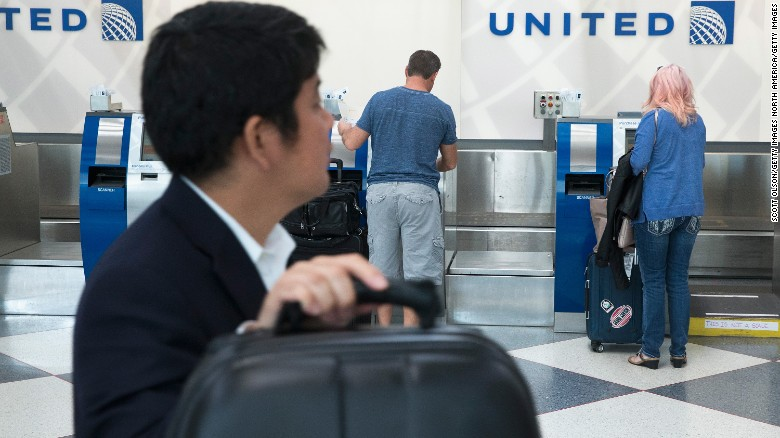 Passengers check-in for flights with United Airlines at Chicago O'Hare Airport in this June 2, 2015 file photo.