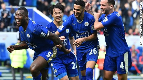 Leicester City's English defender Wes Morgan (L) celebrates after scoring during the English Premier League football match between Leicester City and Southampton at King Power Stadium in Leicester, central England on April 3, 2016. / AFP / BEN STANSALL / RESTRICTED TO EDITORIAL USE. No use with unauthorized audio, video, data, fixture lists, club/league logos or 'live' services. Online in-match use limited to 75 images, no video emulation. No use in betting, games or single club/league/player publications.  /         (Photo credit should read BEN STANSALL/AFP/Getty Images)