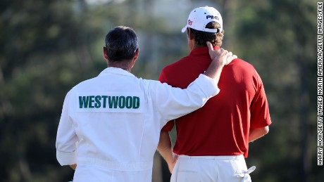 AUGUSTA, GA - APRIL 11:  Lee Westwood of England waits with his caddie Billy Foster on the 18th green during the 2010 Masters Tournament at Augusta National Golf Club on April 11, 2010 in Augusta, Georgia.  (Photo by Harry How/Getty Images)