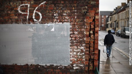 LIVERPOOL, UNITED KINGDOM - DECEMBER 19:  A man walks past Justice for the 96 graffiti outside Liverpool Football Club as the High Court quashes the 'Accidental Death' verdict on December 19, 2012 in Liverpool, England. An application presented by the Attorney General, Dominic Grieve to Lord Chief Justice Lord Judge has resulted in the quashing of the original accidental death verdict and an order for fresh inquests. The Hillsborough disaster occurred during the FA Cup semi-final tie between Liverpool and Nottingham Forest football clubs in April 1989 at the Hillsborough Stadium in Sheffield, which resulted in the deaths of 96 football fans.  (Photo by Christopher Furlong/Getty Images)