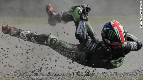 British rider Bradley Smith flies off his Yamaha after falling on Turn 1, during the Moto GP qualifying session at the Termas de Rio Hondo circuit in Argentina, Saturday, April 2, 2016. Smith will start in 12th position at Argentina's Motorcycle Grand Prix, Sunday. (AP Photo/Victor R. Caivano)