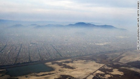 Aereal view of Mexico City blanketed by smog on March 17, 2016. Mexican authorities on Monday triggered an environmental contingency in the overcrowded Mexico City due to the high concentration of ozone recorded in the metropolis, where they recommended to suspend outdoor activities and ordered to reduce automobile traffic. Mexico City is considered one of the most polluted cities in the world. AFP PHOTO/Hector GUERRERO / AFP / HECTOR GUERRERO        (Photo credit should read HECTOR GUERRERO/AFP/Getty Images)
