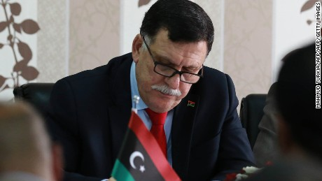 Libya's Prime Minister-designate Fayez Sarraj meets with local mayors inside the naval base in the Libyan capital Sunday.