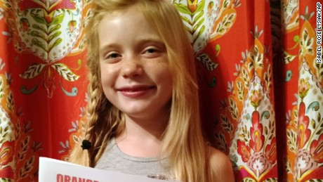 Nine year old reporter, Hilde Kate Lysiak poses for a photo taken by her father, Matthew.