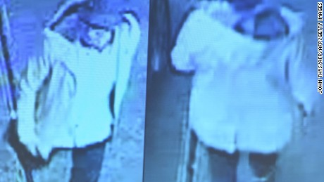 "A photo taken during a press conference to present a police search notice for the third suspect from the Brussels airport attack at the headquarters of the Federal Prosecutor in Brussels on April 7, 2016 shows a scene from video footage showing the suspect leaving the site of the attack. Belgian prosecutors on April 7 launched a fresh appeal for help to find a suspected third attacker in last month's bombings at Brussels airport, releasing new video footage and pictures of the so-called ""man in the hat"". / AFP PHOTO / JOHN THYSJOHN THYS/AFP/Getty Images"