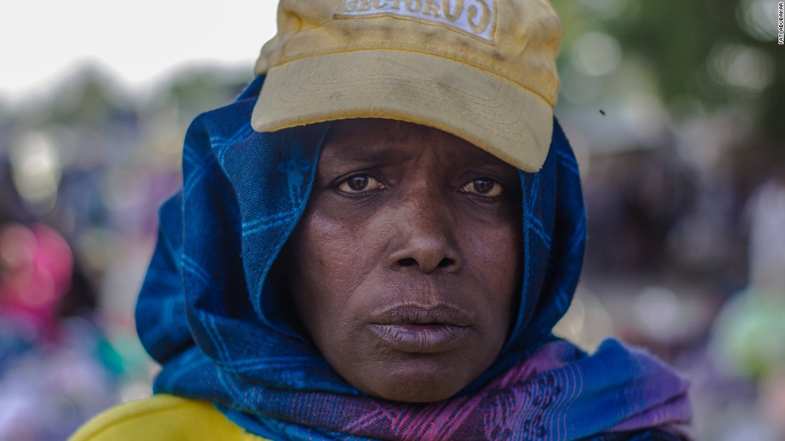 """I come to the market at 6am and sit at my spot. I leave at 6pm. I check all of the women coming into Monday Market. We have to be strict. We have to ensure everyone passes by security checks. I'm dedicated to doing my job."""