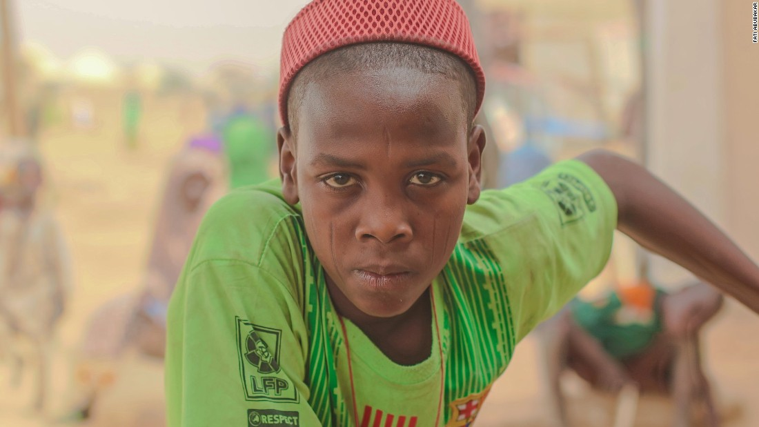 """I don't know where my parents are. I don't know whether they died or are somewhere else after we all ran from our village. But some of my aunts are in another camp. I visit them occasionally. I live here in Kusheri (a new community that moved to Maiduguri). The Bulama (traditional leader) gave me a room. His family feeds me. I don't go to (formal) school but I have joined the other kids in the Islamic school in the neighborhood."""
