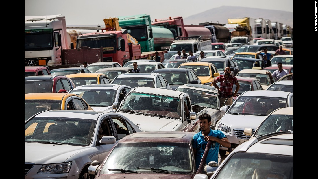 "Traffic from Mosul lines up at a checkpoint in Kalak, Iraq, on June 14, 2014. Thousands of people <a href=""http://www.cnn.com/2014/07/19/world/meast/christians-flee-mosul-iraq/"" target=""_blank"">fled Mosul</a> after it was overrun by ISIS."