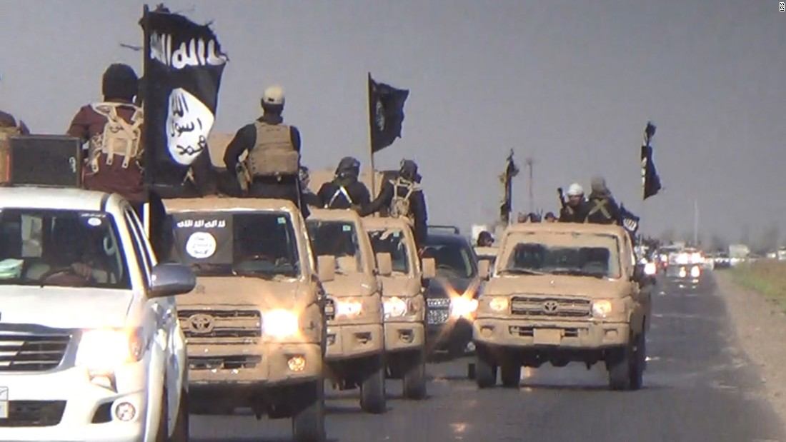 ISIS fighters parade down an Iraqi street in this image released by the group in July 2014.