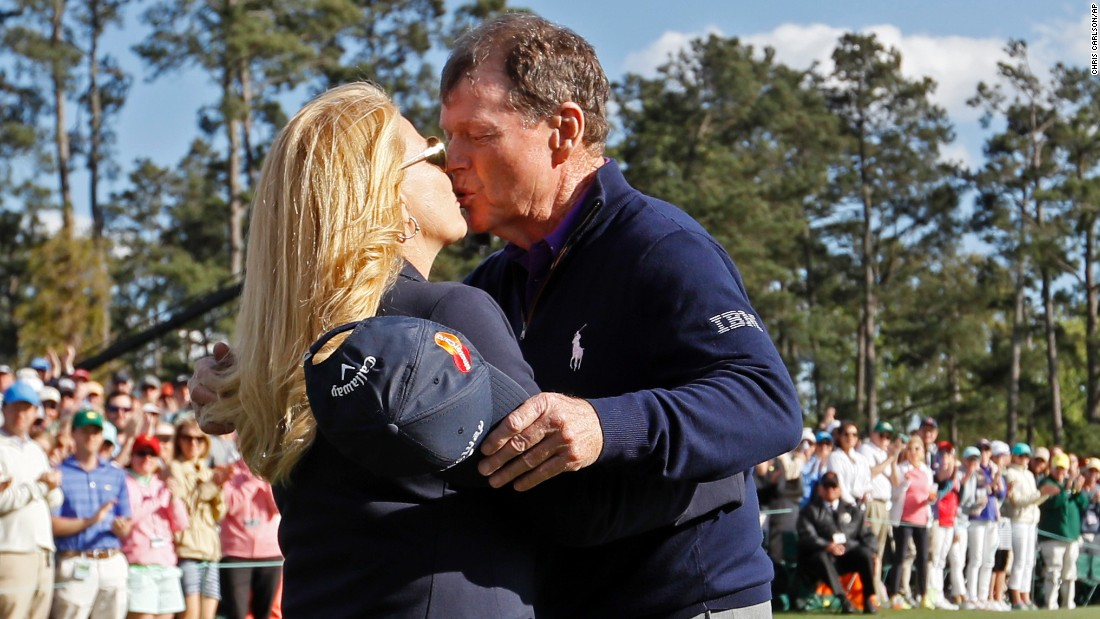 Tom Watson kisses his wife, Hilary, after playing the last round of his Masters career on Friday. Watson, 66, said he will no longer play in the annual event, which he won in 1977 and 1981.