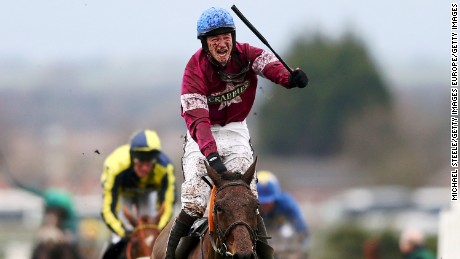 David Mullins riding Rule The World celebrates winning the Crabbie's Grand National steeplechase at Aintree Racecourse on April 9, 2016 in Liverpool, England.