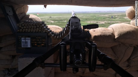 Machine gun manned by Peshmerga fighters at the defensive line just outside al-Nasir village.