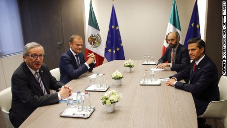 Mexico's President Enrique Pena Nieto (R), European Council President Donald Tusk (2ndL) and European Commission President Jean-Claude Juncker (L) meet during a EU-Mexico summit at the European Council in Brussels, on June 12, 2015. The EU and Mexico agreed on June 8 to update a free trade accord sealed in 2000 to bring it into line with benchmark deals negotiated with Canada and the United States. Mexico is part of the North American Free Trade Agreement which Washington pushed through in 1994 to set the model for others to follow.  AFP PHOTO / POOL / Olivier Hoslet        (Photo credit should read OLIVIER HOSLET/AFP/Getty Images)