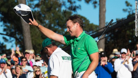 Danny Willett celebrates on the 18th green after wrapping up the 80th Masters with a five-under 67.