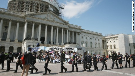 U.S. Capitol Police arrive to arrest Democracy Spring protesters participating in a sit-in at the U.S. Capitol to protest big money in politics, April 11, 2016 in Washington, DC.