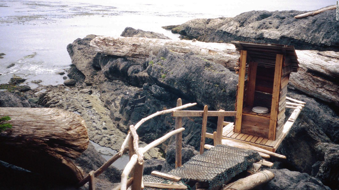 Twice-daily tides wash away the waste from this wooden outhouse.