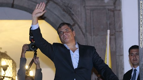 Ecuadorean President Rafael Correa waves to supporters, from the balcony of the Carondelet presidential palace during a demonstration in Quito on April 7, 2016. Correa's supporters reacted to opposition protests against controversial tax increases pushed by the president. / AFP / Juan Cevallos        (Photo credit should read JUAN CEVALLOS/AFP/Getty Images)