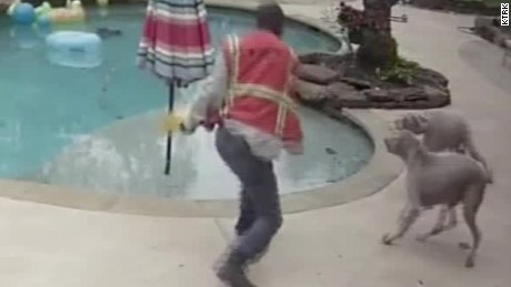 contractor hits dogs with wrench on cam pkg _00005609