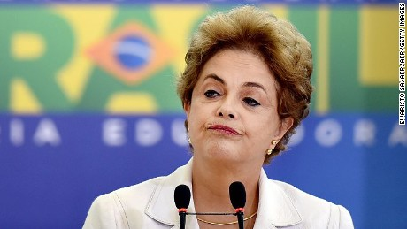 Brazilian President Dilma Rousseff gestures during the Education in Defense of Democracy event, at the Planalto Palace in Brasilia, on April 12, 2016.  Rousseff entered the final straight Tuesday of a desperate battle to save her presidency ahead of an impeachment vote in Congress this weekend. / AFP / EVARISTO SA        (Photo credit should read EVARISTO SA/AFP/Getty Images)