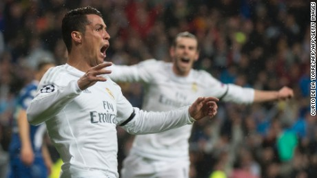 Real Madrid's Portuguese forward Cristiano Ronaldo celebrates after scoring during the Champions League quarter-final second leg football match Real Madrid vs Wolfsburg at the Santiago Bernabeu stadium in Madrid on April 12, 2016. / AFP / CURTO DE LA TORRE        (Photo credit should read CURTO DE LA TORRE/AFP/Getty Images)