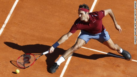 Switzerland's Roger Federer reaches for the ball to Spain's Guillermo Garcia-Lopez during the Monte-Carlo ATP Masters Series Tournament, on April 12, 2016 in Monaco.  AFP PHOTO / VALERY HACHE / AFP / VALERY HACHE        (Photo credit should read VALERY HACHE/AFP/Getty Images)