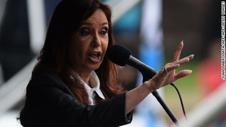 Argentine former president Cristina Fernandez de Kirchner delivers a speech before supporters gathering in front of the Comodoro Py courthouse where she testified before federal judge Claudio Bonadio over corruption allegations, in Buenos Aires on April 13, 2016. Fernandez de Kirchner testified in an investigation into whether she mishandled public funds in connection with Central Bank currency-related operations during the final months of her presidency. The charges, ranging from embezzlement to money laundering, come amid an atmosphere of political polarization in Argentina and accusations of bias among prosecutors and judges. / AFP / Juan Mabromata        (Photo credit should read JUAN MABROMATA/AFP/Getty Images)