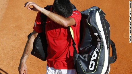 Serbia's Novak Djokovic leaves the court after losing a tennis match during the Monte-Carlo ATP Masters Series tournament, on April 13, 2016 in Monaco. .  AFP PHOTO / VALERY HACHE / AFP / VALERY HACHE        (Photo credit should read VALERY HACHE/AFP/Getty Images)