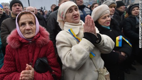 """Elderly women pray during a rally on Independence Square in Kiev on February 21, 2016. Protesters of the Radical Right Power organization pitched tents on the square and declared the """"Third Maidan"""", demanding the resignation of Ukrainian President Petro Poroshenko and his governmant. / AFP / SERGEI SUPINSKY        (Photo credit should read SERGEI SUPINSKY/AFP/Getty Images)"""