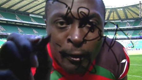 Collins Injera signs a TV camera after scoring his 200th sevens try, against Japan in 2015.