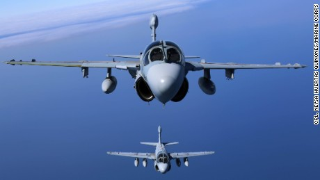 """Two EA-6B Prowlers belonging to each Prowler squadron aboard Marine Corps Air Station Cherry Point conducted a """"Final Four"""" division flight aboard the air station March 1, 2016. The """"Final Four"""" flight is the last time the Prowler squadrons will be flying together before the official retirement of Marine Tactical Electronic Warfare Training Squadron 1 at the end of Fiscal Year 16 and the eventual transition to """"MAGTF EW"""". MAGTF EW is a more distributed strategy where every platform contributes to the EW mission, enabling relevant tactical information to move throughout the electromagnetic spectrum and across the battlefield faster than ever before. (U.S. Marine Corps photo by Cpl. N.W. Huertas/Released)"""