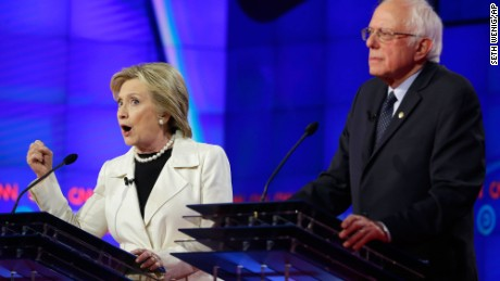 Hillary Clinton, left, speaks while Sen. Bernie Sanders, I-Vt., listens during the CNN Democratic Presidential Primary Debate at the Brooklyn Navy Yard on Thursday, April 14, 2016 in New York. (AP Photo/Seth Wenig)