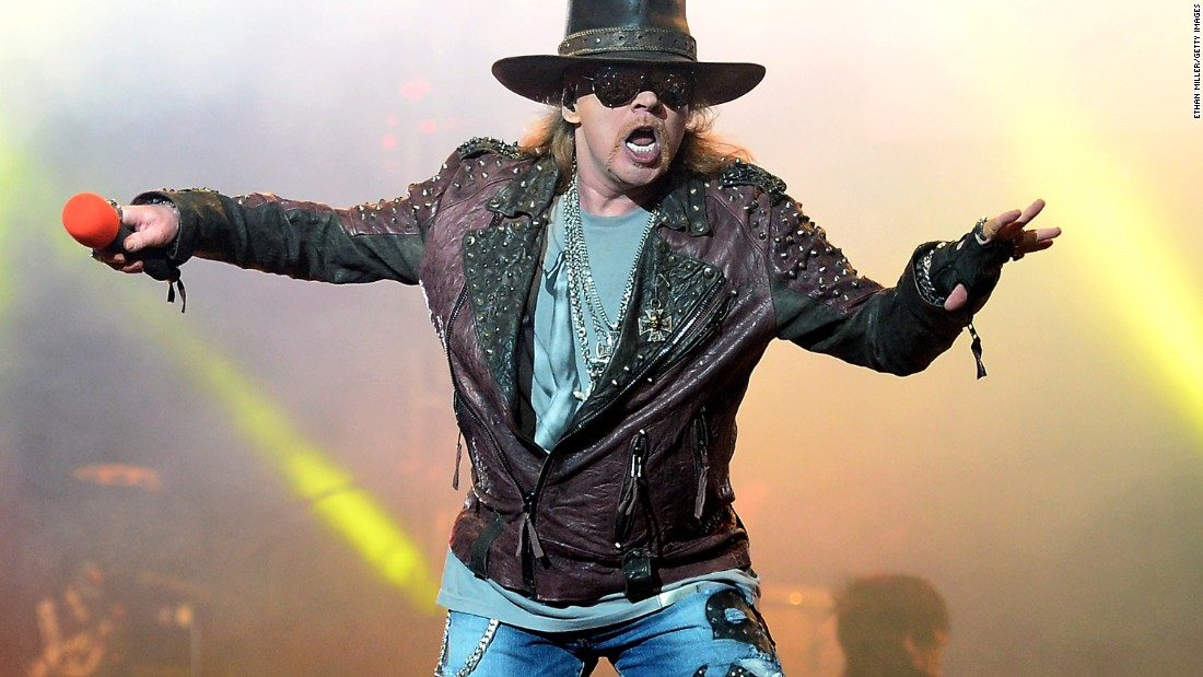 Guns and Roses singer Axl Rose will join AC/DC on world tour, including rescheduled U.S. dates, according to band statement.