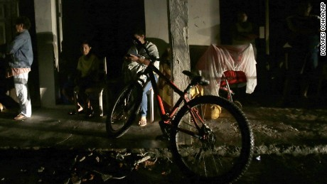 Residents sit in the street in prevention of an aftershock in the Pacific coastal town of Pedernales, Ecuador, Sunday, April 17, 2016. The strongest earthquake to hit Ecuador in decades flattened buildings and buckled highways along its Pacific coast, sending the Andean nation into a state of emergency. As rescue workers rushed in, officials said Sunday at least 77 people were killed, over 570 injured and the damage stretched for hundreds of miles to the capital and other major cities.(AP Photo/Dolores Ochoa)
