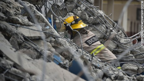Rescue workers search the rubble after a 7.8-magnitude quake in Gauyaquil, Ecuador on April 17, 2016.  At least 235 people were killed when a powerful earthquake struck Ecuador, destroying buildings and a bridge and sending terrified residents scrambling from their homes, authorities said Sunday. / AFP / LUIS ACOSTA        (Photo credit should read LUIS ACOSTA/AFP/Getty Images)