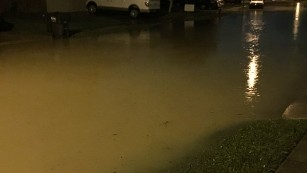 An image of flooded streets in a Houston neighborhood.