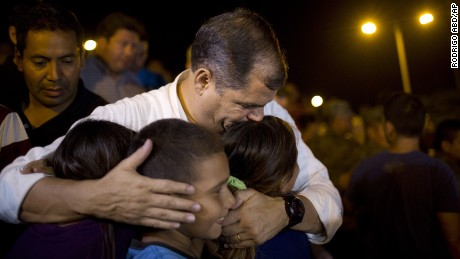 Ecuador's President, Rafael Correa, kisses a group of children after meeting with local authorities at the emergency center in Portoviejo, Ecuador, Sunday, April 17, 2016.