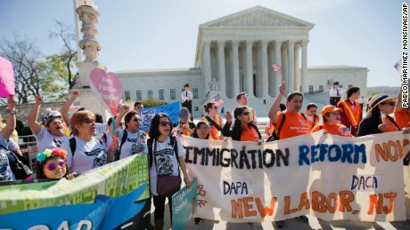 Supporters of fair immigration reform gather in front of the Supreme Court in Washington, Monday, April 18, 2016.